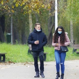 Masks and social distancing 'could last years'